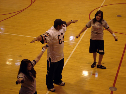 Chicago Bear Roberto Garza offered some wieght-training tips to students in a gym class at Bristol School during a visit on Tuesday. /Lisa Weiner photo