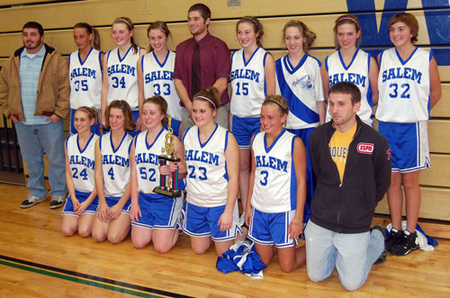 The Salem girls basketball A team poses with their coaches and tournament trophy.