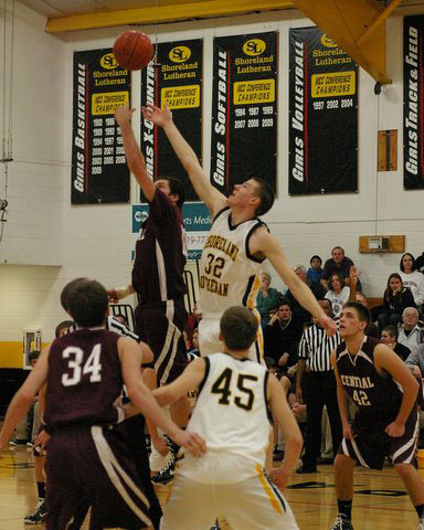 Dustin Milz goes up for the tip against Shoreland. /David Thoss photo