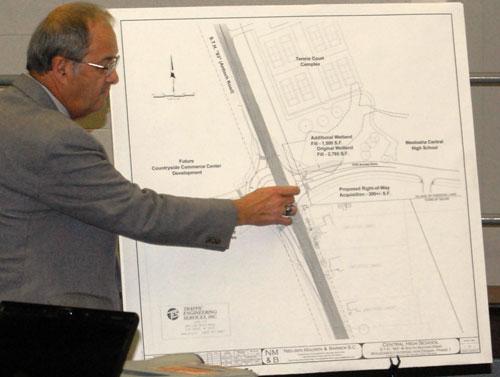 Traffic engineer Wayne Higgins explains aspects of roundabout design.