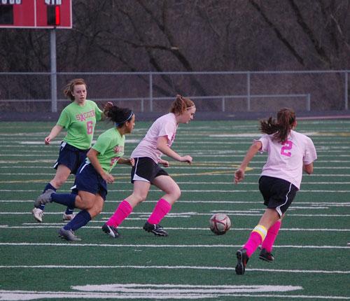 Wilmot's Kristen Weiler and Lauren Romani -- sporting pink uniform shirts -- bring the ball up the field versus Racine park Thursday evening.