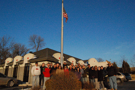 Friends of Tom Paddocks gathered to lower the flag on the pole outside the offices of Paddock State farm in Paddock Lake Tuesday afternoon.