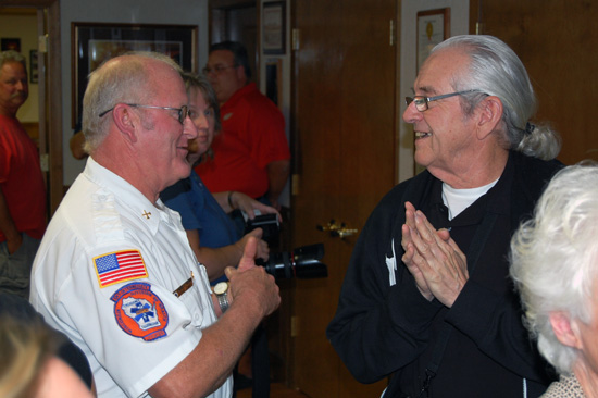 Twin Lakes Rescue EMS Chief Darrel Stoen (left) chats with Joseph Sheedy.
