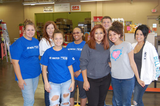 The volunteers working at The Sharing Center pose for a group photo.