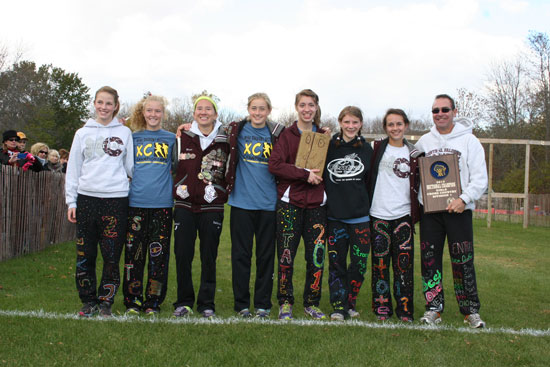 The state qualifying girls cross country team: (from left) Maddie Murphy, Joann Reiners, Maria Sabourin, Kenzie Bevery, Renee Culbertson, Becca Lamp, Melissa Capra,and Coach Keith Olsen /Nicolas Keller photo