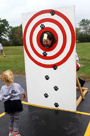 Principal/district administrator Roger Gahart took his turn as the target in the ever popular (for the students anyway) sponge throwing booth. /Earlene Frederick photo