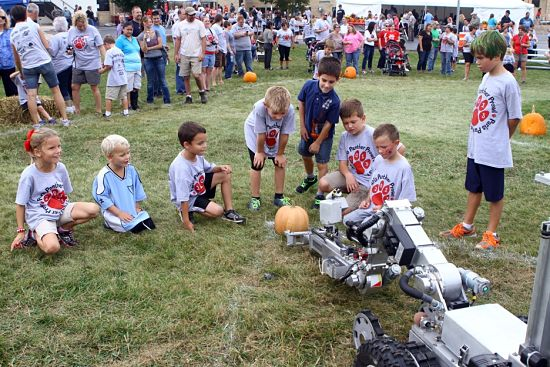 The Sheriff's Department bomb squad robot demonstrated some of its abilities with a pumpkin, right in sync with the season. /Earlene Frederick photo