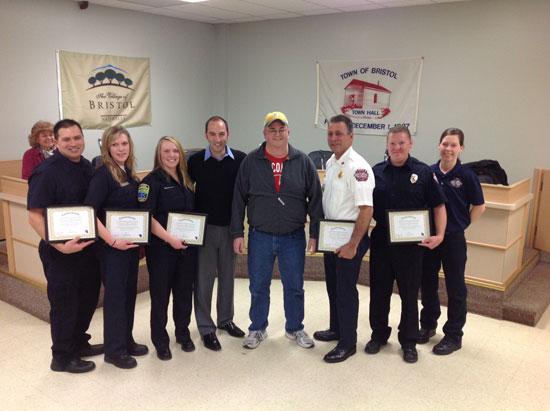 Members of the Bristol Fire and Rescue crew that were on the call that saved the life of Brian Mickelson pose with Dr. Ben Feinzimer (center left) and Mickelson (center right).