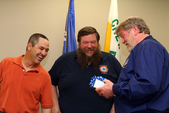 The Trevor Fire Association Ron Edmonds, president and Ed Herreid, past President and board member presented Tom with a military style Colt 45.  It was customized to represent the Trevor Fire Department and the Marine Corps, with whom Tom served in Vietnam.