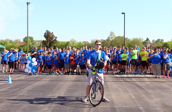 Principal Ben Walshire led the runners/walkers. They assembled for the National Anthem before they started.