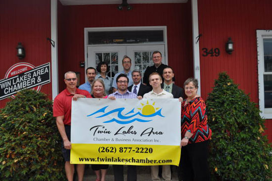 (Front row from left) Jim Little, Minuteman Press; Diane Lindstrom, Keller Williams Realty; Travis Wetzel, WUHS; Adam Fitzgerald; Marilyn Trongeau, Chamber Director; (Second row from left)  James Pittman, Discover Acupuncture; Patrick DeMoon, Attorney; Randy Sherwood, First Merit Bank; (Back Row from left) Barbara Goodnough, Shorewest Realtors; Chris Brown, Slades Corners Computer Repair; Brian Hochschild, Bahr &Kadlec CPA./Submitted photo