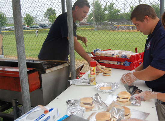 Bristol village administrator and fire department member  Randy Kerkman takes some burgers off the grill at the Bristol Fire Department burgers booth.