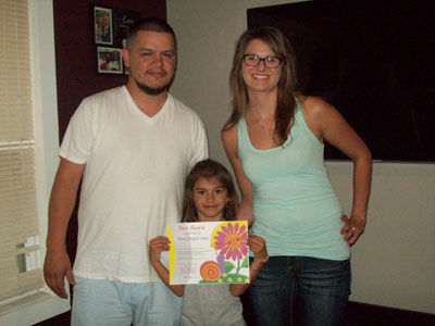 Olivia (center) with her parents Luis & Liane. /Contributed photo