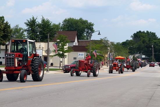 The tractors traveled through the Village.