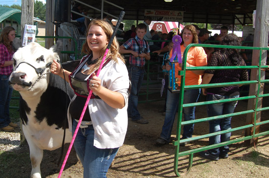 Ashley Panek and her gand champion steer.