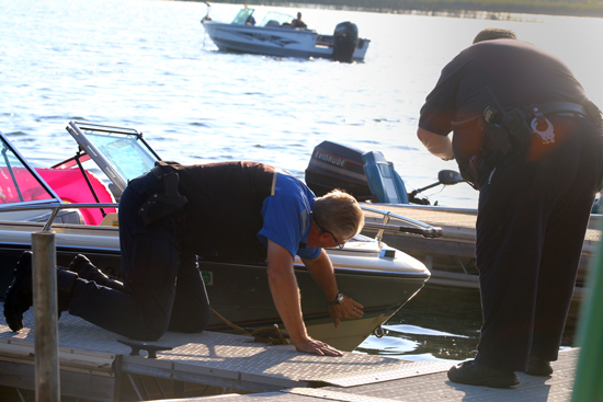 Police and Water Patrol check out the boat that was hit. They dropped off the ones on the boat that hit them by a house on Lakeshore Way, then came to the Sand Bar.