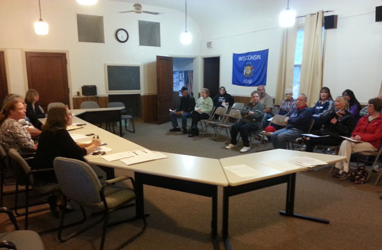 US Postal Service officials address the public at Randall Town Hall in Bassett on Tuesday.