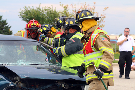 Firefighters demonstrate how they cut a car apart as Somers Fire Chief Tom Smith explains what they are doing.