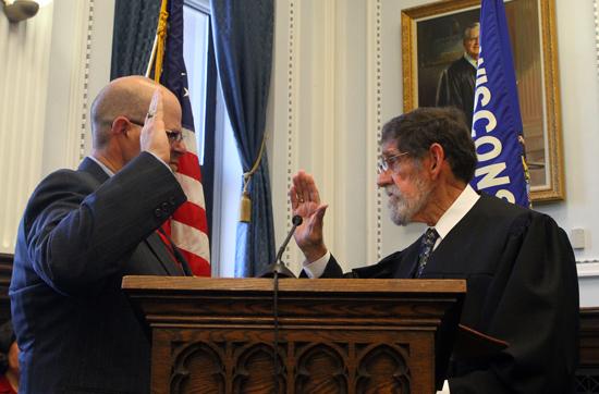 Judge David P. Wilk sworn in by his father Judge S. Michael Wilk.