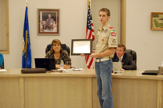 Evan Kirsch presents  the certificate from Monarch Watch to the Salem Town Board.