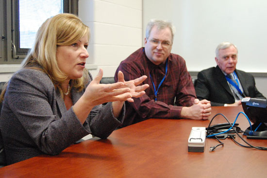 New Trevor-Wilmot Consolidated District administrator Michelle Garven (left) meets with reporters at the school Friday. In the center is school bord President Tom Steiner and current district administrator George Steffen at right.