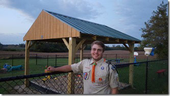 /Nick Penge and his Eagle Scout Project in the background.