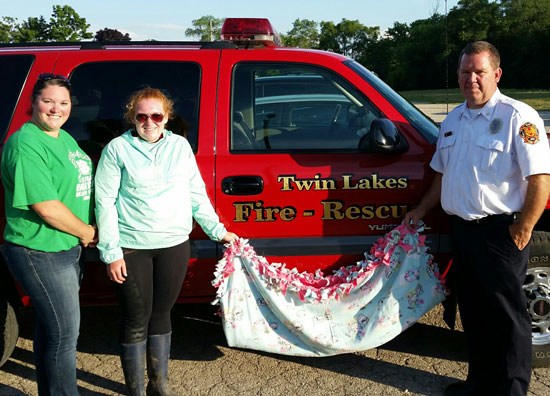 Lori Harpster General Leader, Cassidy Dabbs Youth Member who organizied the project and Tom Smith from Twin Lakes Rescue Squad.